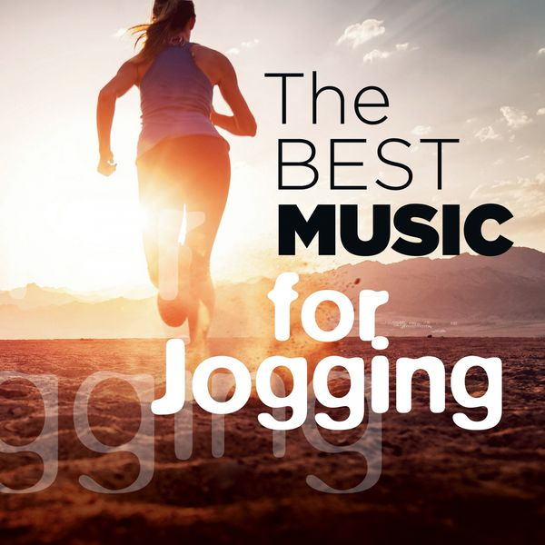 Woman listening to music and jogging stock photo image of.